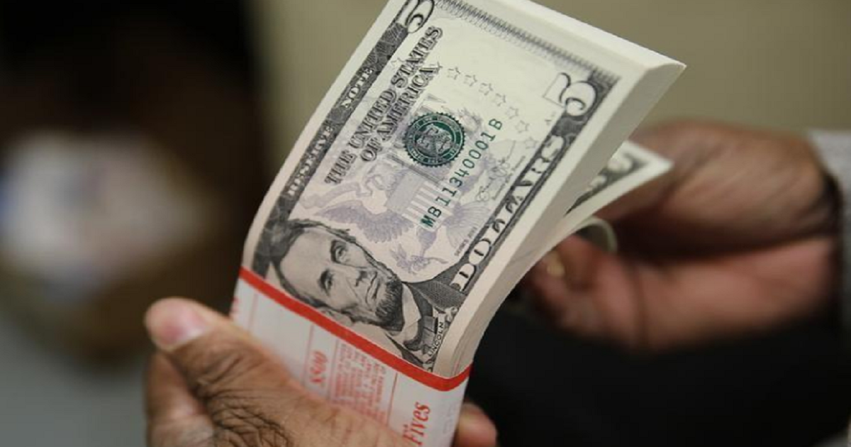 Dollar index hits one-month low, bitcoin slides again