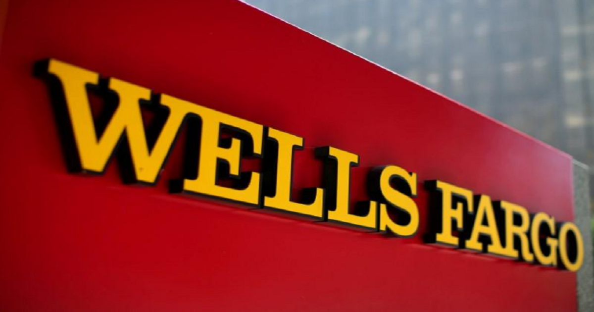 Wells Fargo trims expected hit from regulatory cap on assets